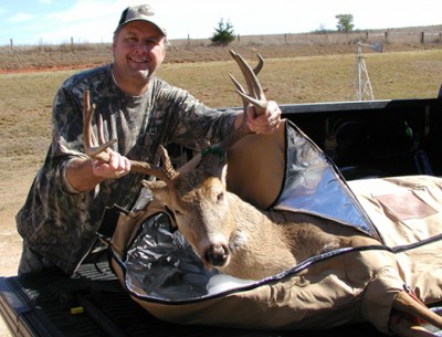 Steve Glass posing with his most recent kill ready to go in a Trophy Bag Kooler