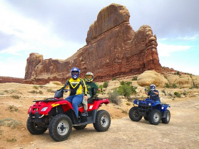 Riding an ATV by a finin Moab, Utah