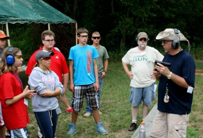 Tom Johnston, Ohio 4H Lead Pistol Instructor, introduces the campers to the new S&W M&P22 pistol at the 2012 Shooting Education Camp.