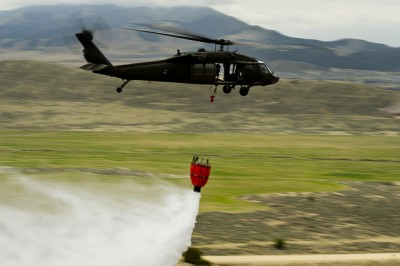 Utah National Guard practices wildland fire fighting by dropping water over West Jordon, Utah on April 17, 2012.