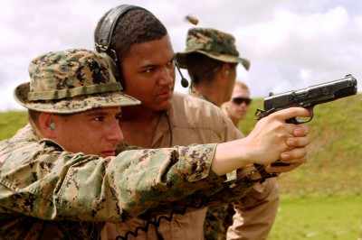 A marine fires the current version of the MEU(SOC) pistol (not the Rail Gun rumored to be the competition's winner) in a firing drill.