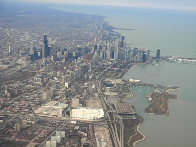 View of downtown Chicago from a plane. Northerly Island is the stretch of green peninsula at the bottom right corner of the frame.
