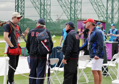 Struggling to figure out what was going wrong, SSG Josh Richmond, U.S. Army Marksmanship Unit, talks it over with the coaching staff in between qualification rounds of the Olympic double trap competition Wednesday at the Royal Artillery Barracks shotgun range. Richmond came up short of an Olympic medal, finishing in 16th place in his Olympic debut.