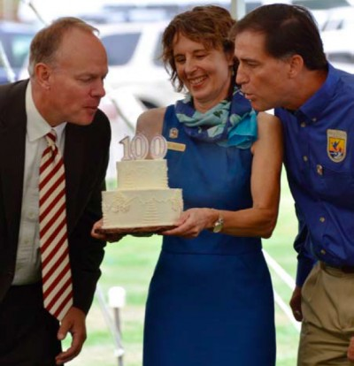 Wyoming Governor Matt Mead and USFWS Director Dan Ashe blow out the candles on the National Elk Refuge's centennial birthday cake during a public ceremony on August 10.