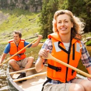 Couple wearing their life jackets while canoeing