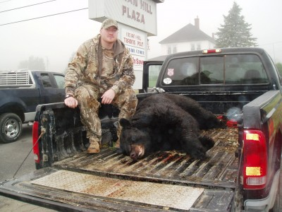 Knox with his 669-pound bear. Image courtesy of John Longergan.