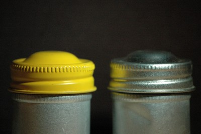 Old metal film canisters, not necessarily the ones used by Taylor.