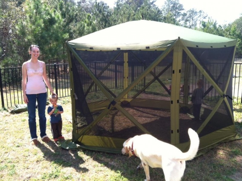 Amanda, pictured with her son Grayson by her side and Owen inside the Six Pack 1660 Mag Screen Tent, loved the durable material. It felt sturdy enough to last for years—even with kids.