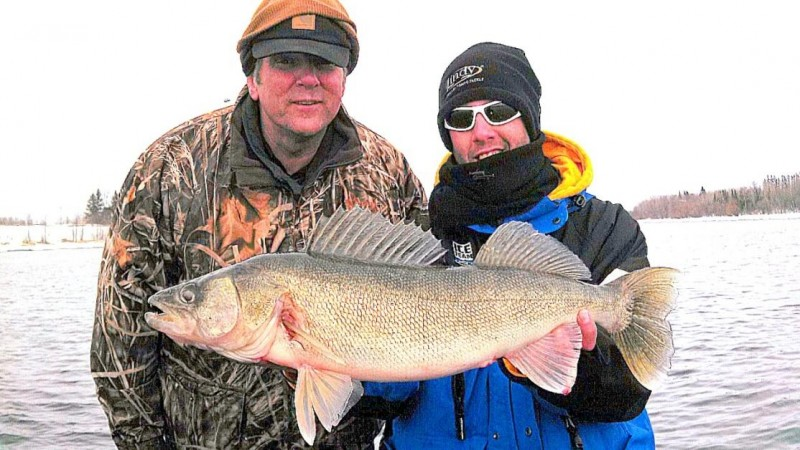 Kurt Hinton with his guide Matt Breuer of Northcountry Guide Service with a 28-inch walleye on the early Rainy River season.