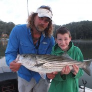 My grandson, Charlie, and Rod Salyers of Lateral Line Charters with a typical catch from one of Salyers' trips.
