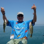 Richard Holm holds up two Lake Michigan perch.