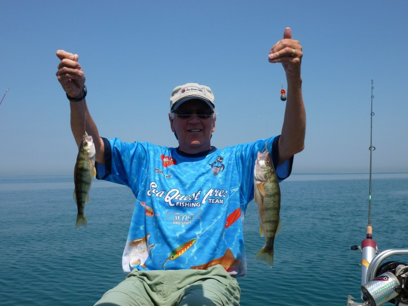 Richard Holm holds up two Lake Michigan perch.