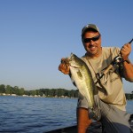 Mark Zona shows off a deep-water bass caught on a southwest Michigan lake.