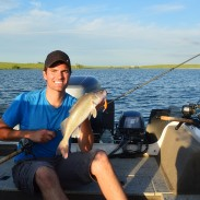 Local guide and professional fisherman Tyler French with a dandy walleye from South Dakota's Belle Fourche Reservoir. Anglers of all stripes will find a playground in and around Deadwood.