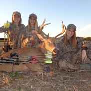 Bowhunting Spoelmans (from left) Mychala, Jamie, and Samantha pose with a nice buck their father Joel Spoelman harvested last weekend. Bowhunting is a family affair for the Ravenna, Michigan family. Image courtesy of Joel Spoelman.