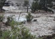 A road turned into a river at the height of a recent flash flood in the American Southwest.