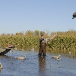 John Bakos tooses out decoys for an afternoon hunt.