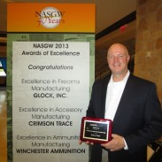 Crimson Trace President Lane Tobiassen with the Excellence in Accessory Manufacturing award.