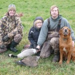 Todd Achterhof, Andrea and Kevin Essenburg, and Gabe pose with two geese taken at the Fennville Farm Managed Hunt Unit in southwest Michigan.