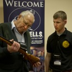 Legendary custom gunmaker Jerry Fisher examines a student's work at GCCF 2013.