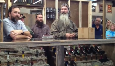 Phil Robertson speaks to a crowd of fans and customers as he recalls the story of his first duck call.