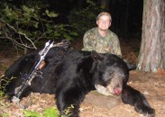 One of the key components to finding big bears is low hunting pressure. Here's Adam Beason with a 560-pound bear killed in Arkansas in 2010. Image courtesy Bernie Barringer.