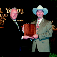 Jim Heffelfinger receives the Pope & Young Club Lee Gladfelter Memorial Award from Club Conservation Chairman.