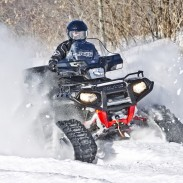Tracks can turn any ATV into an all-terrain tank, ready to go anywhere, year-round. Image courtesy Polaris.