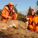 Tom Heberlein, left, and Chris White pose with the big eight-point buck that White shot November 23 near Cayuga.