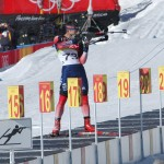 A competitor takes aim in one of the shooting portions of a 20-kilometer biathlon event at the 2006 Winter Olympics in Torino.