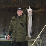 Miles Hanley built an affordable steelhead boat so he could catch river fish, like this 12-pounder.