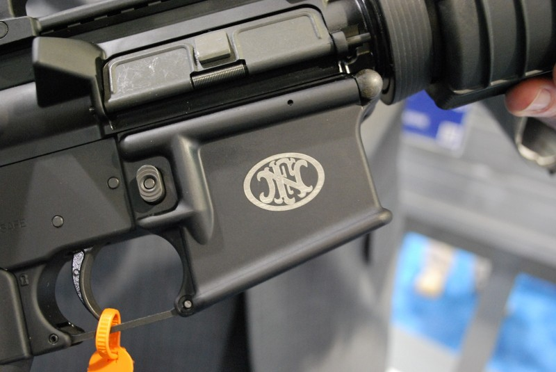 The FNH USA rollmark on the FN 15 lowers.