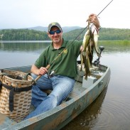 Vermont Fisheries biologist Shawn Good displays a stringer of bass caught on Kent Pond, Killington. The fishing excursion is featured in a segment of Outdoor Journal's new season.