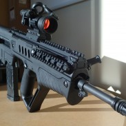 The author's Tavor SAR TSB18 with an Aimpoint PRO red dot sight.