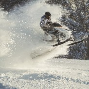 You, too, can have this much fun snowmobiling this season. If you're looking to buy a new one, though, there are some things you'll want to keep in mind. Image courtesy Arctic Cat.
