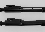 The Rubber City Armory Low Mass Bolt Carrier Group (top) is machined to maintain contact in critical areas, but weighs over 25 percent less than a standard Colt carrier.