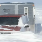 One angler claims that snowdrifts as high as seven feet covered his ice house on last week.