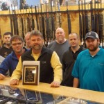DNW Outdoors staff poses with the Outdoor Member of the Year plaque awarded to them at the Sports, Inc. Outdoor Sporting Goods Show in February.