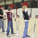 Dereck Bowman (l) and Bailey Mehrhoff (r) of South Harrison R-2 schools in Bethany were among the many student archers at the MoNASP 2013 state tournament. At center is Anthony Emery of Mountain Grove Middle School.