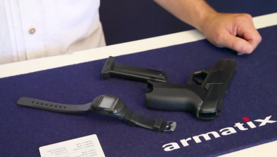 The Armatix iP1 pistol with its accompanying RFID watch.