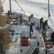 A Coast Guard cutter breaking ice in Lake Superior for cargo ships to cross safely.