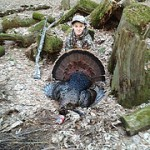 Ben Hooker bagged this gobbler during the Illinois Youth Turkey Hunt. Hear about Ben's hunt on Outdoors Radio Show 916.  photo courtesy of Ben Hooker.