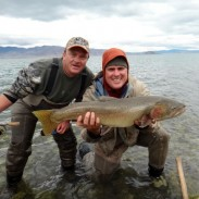 Fishing guide Rob Anderson (left) and angler Peter Binaski (right) pose with their possible record fish.