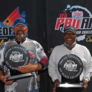 First-place pro-angler Eddie Adams (left) and first-place co-angler Charlie Roberts (right) pose with their trophies at the Lucas Oil IFA Pro-Am Redfish Challenge at Chalmette, La., on March 30.