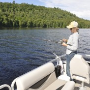 Resist the temptation to give the rod a hard yank when you find your bait is snagged. Follow this guy's lead by giving it a steady pull, while donning sunglasses to protect your eyes in case the lure snaps free and rockets back to the boat.