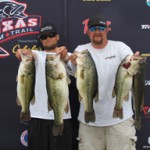 First-place finishers Eric Wright (left) and Jeremy Sims (right) hold up their winning fish at the Texas Team Trail Event at Lake Texoma on Saturday, April 12.