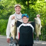A father and son with some big 'ol bass caught during the 2013 LCI Father's Day Derby presented by Yamaha.