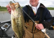 Soft plastic baits have been netting fish like this big bass, fooled by a fake craw-patterned plastic, for six decades.