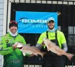 Todd McKellar and Bart Crader land a two-fish total weight of 15.29 pounds.