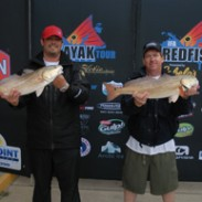 First-place finishers Brad White (left) and Ron Henne Jr. (right) pose with their trophies at the IFA Redfish Tour event at Port Aransas, Texas, on April 5.